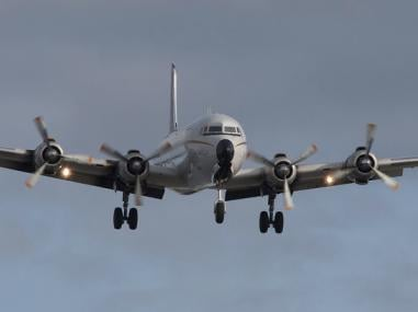 Larger cargo airplane coming in for landing with cargo load.